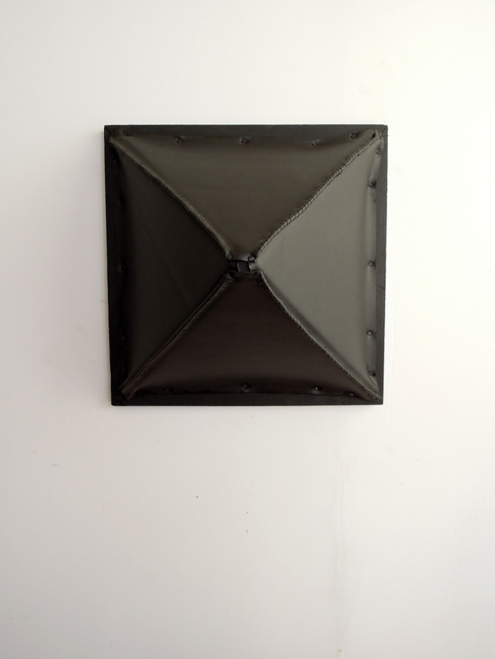 """Rivet"" 2012. Vinyl, wood, latex paint, thread, cut tacks. 16 x 16 x 10 inches"